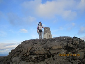 Georgina on Ben Nevis Summit while doing Youngest Solo 3 Peaks Challenge